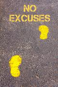 Yellow footsteps on sidewalk towards No excuses message.Conceptual image Stock Photos