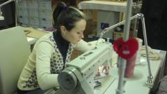 Woman seamstress working on the sewing machine Stock Footage