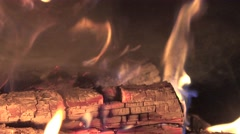 Flames on dying embers in fireplace, in  fire, in stove, 4k Stock Footage