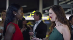 4K Attractive female friends at sophisticated party embrace and chat together - stock footage