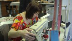 The woman, a seamstress working on the sewing machine Stock Footage