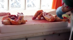 Stock Video Footage of Butcher Chopping a Chicken in Half