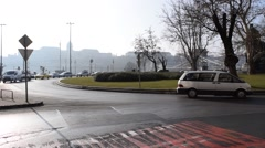 A Roundabout in Pest, With a Hazy Obscured Buda Castle and Chain Bridge - stock footage