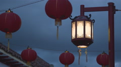 Chinese Streetlight with Red Lanterns Swaying Stock Footage