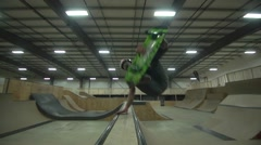 Extreme Sport Skateboarding in Indoor Skate Park with Wooden Ramps - Stock Footage