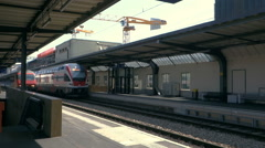 Arrival of intercity train to a railway station - stock footage