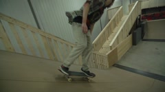 Stock Video Footage of Extreme Sport Skateboarding in Indoor Skate Park with Wooden Ramps -