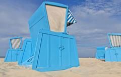 Hooded beach chairs (strandkorb) at the Baltic seacoast - stock photo