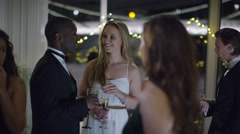 4K Portrait of beautiful young woman standing alone at sophisticated party - stock footage