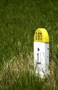 Old kilometre marker in the country Stock Photos