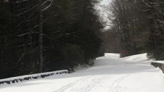 Snow covered road winter Stock Footage