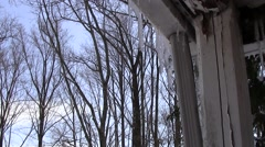 Icicles dripping on sunny day Stock Footage