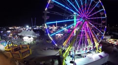 Night view of a fair grounds and a spinning ride Stock Footage