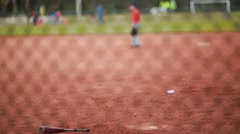 A Baseball Bat Laying down in the field Stock Footage