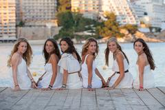 Group of girls dressed in white for beach party Kuvituskuvat