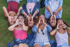 Group of kids shouting or singing Kuvituskuvat