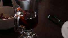 Group of people drink mulled wine in cafe Stock Footage