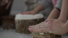Daughter, mother and grandma making cheese. Stock Footage