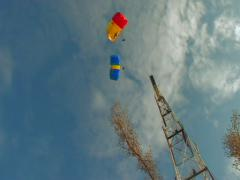 BASE jumping  skydiving from the antenna. Stock Footage