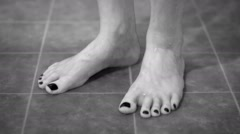 Feet of a Tourist in Shower in Monochrome Stock Footage