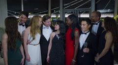 4K Portrait of attractive mixed ethnicity group of friends at glamorous party - stock footage