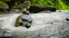 Video 1920x1080 - Whitewater Churns and Tumbles toward a Waterfall with Sound Stock Footage