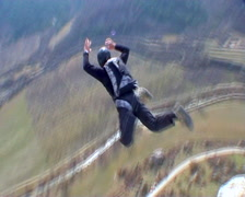 BASE jumping  skydiving from the mountain. Stock Footage