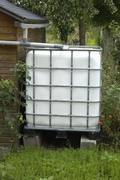France, rainwater tank in a garden in Les Mureaux - stock photo