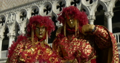 Two venetian masks red with feathers Stock Footage
