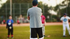 Male coaching kids during practice at Baseball Field - stock footage