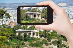 Tourist taking photo of temple in Athens Stock Photos