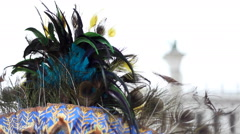 From behind mask covered od feathers looking at St. Mark Square in Venice. Stock Footage