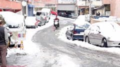 ISTANBUL, TURKEY - FEBRUARY 2015: scooter courier riding, snowy streets Stock Footage
