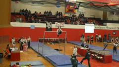 College girls gymnastics slow motion dismount from parallel bars Stock Footage