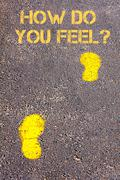 Yellow footsteps on sidewalk towards How Do You Feel message.Concept image - stock photo
