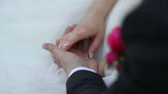 Couple hands together at wedding Stock Footage
