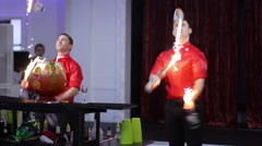 Barman show. Two men juggle flaming bottles and breathing fire Stock Footage