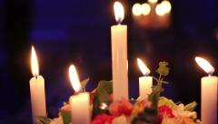 Beautiful candles in restaurant at table (rack focus) Stock Footage