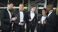 4K Portrait of male friends or business colleagues at formal social event Stock Footage