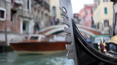 Close up of gondola's row iron rocking in the canal in a venetian canal. Stock Footage