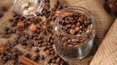 Top of bottle with coffee beans on background, hazelnut, cinnamon, anise, slow Stock Footage