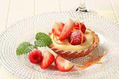 Dessert - Small custard tart with fresh fruit - stock photo