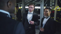 4K Male friends or business colleagues drinking &chatting at formal social event Stock Footage