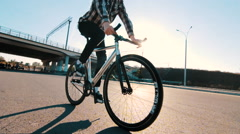 Boy riding fixed gear bike on the road Stock Footage