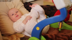 8 month baby playing with own legs Stock Footage