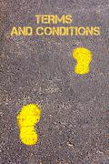 Yellow footsteps on sidewalk towards Terms and Conditions message.Concept ima - stock photo