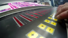 4K offset machine press operator adjust print fountain key unit. UHD stock vi Stock Footage