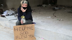 Homeless woman begging Stock Footage