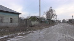 Rural road in an old abandoned wooden village in woods, 4k Stock Footage