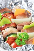 Pork and vegetable skewers in aluminum foil Stock Photos